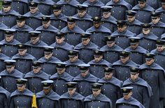 Army cadets march onto to the field before an NCAA college football game between the Army and the Navy Saturday, Dec. 8, 2012, in Philadelphia. (AP Photo/Matt Rourke)