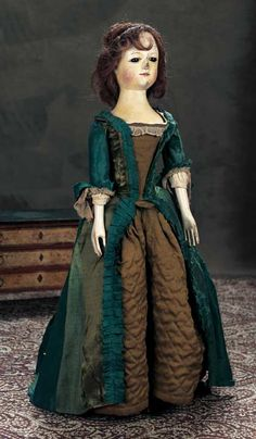 "Theriault's - 24"" Early English wooden doll with Highly Characterized Expression, Wearing Original Gown,  c early 1700s"