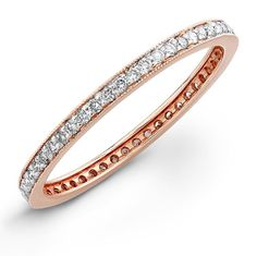A simple rose gold eternity band to go with your beautiful blush wedding dress.