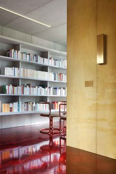 #Concrete Flat in Paris by Rodolphe Parente   @yellowtrace =  Love that glossy marquetry mahogany floor stained brilliant red and those concrete floating shelves!