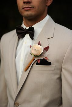 love the look; bowtie brings a classic/vintage feel for a semi-rustic wedding