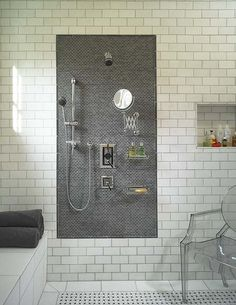 Large shower or wet room? Either way, it's fabulous! Black and white bath with subway tile.