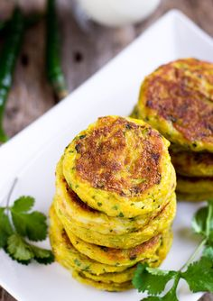Indian Potato Patties (Aloo Tikki)    3 large potatoes     3 cups water (approximately)     2 tablespoons all-purpose gluten-free flour     1 long green chili, finely chopped     ¼ teaspoon turmeric powder Coupons     ¼ teaspoon garam masala     ½ teaspoon chaat masala     ¼ cup diced yellow onion     ¼ cup chopped cilantro leaves     ¼ cup canola oil