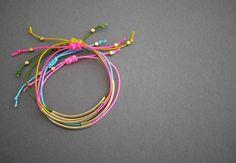 Gold tube bracelets.