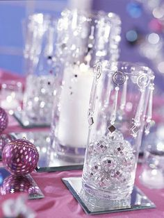 Multiply sparkle and candlelight by using Inexpensive mirror coasters, ornaments, and charms to add a festive look and combine easily with most any color of table linens. Look for mirrored pieces at crafts, party, or floral supply stores. Wedding Centerpieces, Wedding Decorations, Quinceanera Decorations, Quinceanera Party, Centrepieces, Table Decorations, Bling Centerpiece, Glass Centerpieces, Winter Decorations