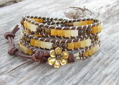 Ombre Yellow Jade leather wrap with tiger's eye, Czech glass, Toho seed beads, gold flower button and distressed leather cord.yet another awesome wrap bracelet Leather Jewelry, Beaded Jewelry, Jewelry Bracelets, Handmade Jewelry, Wrap Bracelets, Beaded Leather Wraps, Leather Cord, Tiger Eye Jewelry, Look Boho