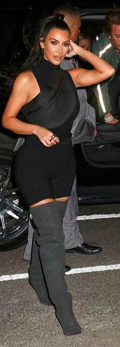 Kim Kardashian wearing Shirt, purse, shorts, and shoes – Yeezy