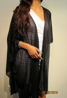 Love this ruana wrap for spring http://www.yourselegantly.com/dressy-evening-shawls/chiffon-shawls/long-black-summer-ruana-wrap-coverup.html