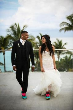 The Couple Take A Walk In Comfortable Sneakers The Couple Take A Walk In Comfortable Sneakers sneakers bride groom persian western wedding gown fashion mens wear outdoors oceanfront Carrie Zack Events Inbal Dror Haute Couture Tom Ford Alain Martinez Photography Fontainebleau Hotel