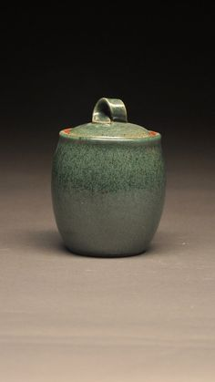 Ceramic lidded jar on Etsy, $12.00  Love the handle on this- maybe add matching ones on the sides for a casserole dish