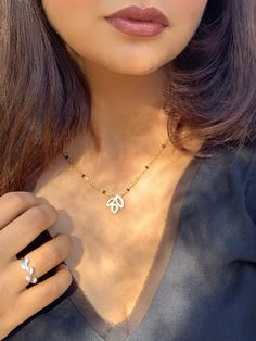 This mangalsutra will give you a dainty look that you can wear daily. Indian Wedding Jewelry, Indian Bridal, Indian Jewelry, Bridal Jewelry, Diamond Mangalsutra, Natural Diamonds, Peonies, 18k Gold, Arrow Necklace