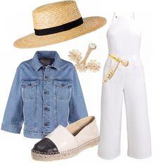 Tuta jumpsuit bianca, giubbotto jeans, espadrillas bicolore e paglietta. Uno stile sobrio ma comunque chic, come una celebrità a passeggio sulla Croisette di Cannes.