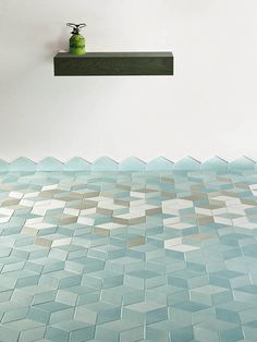 PRODUCT: Tex by Raw Edges Studio for Mutina. Tex is a rich multi-colored glazed porcelain collection inspired by woven textiles. It features an artisanal, hand-crafted surface texture and a unique rhombus shape.