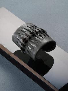 Leather cuff~ This would look great with a bright color under the braided leather.