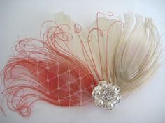 Wedding Bridal Ivory Coral Pink Peacock Feather Pearl Rhinestone Jewel Veiling Head Piece Hair Clip Fascinator. $35.00, via Etsy.