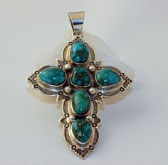 Sterling Silver Cross Pendant.   #nativeamericanjewelry    #turquoisejewelry http://www.leotasindianart.com/