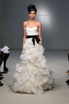 Emphasis by CONTRAST:  This Vera Wang wedding dresses shows emphasis by contrast by using the contrasting colors of white and black. The black sash is the focus of the dress. It also adds variety to the design.     vera-wang-wedding-dresses.gif 300×450 pixels