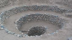 Ancient spirals in Peruvian desert used as 'sophisticated' irrigation system.  Strange spiraling holes dotted across the arid valleys of southern Peru have puzzled generations of archaeologists. The funnel-like shape helped to draw the wind down into the underground canals  [Credit: Ab5602/WikiCommons] But researchers believe they may have solved the mystery of the Nazca holes, known as puquios, with the help of satellite images and data. They said the holes formed part of a…
