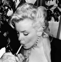 In 1956, Marilyn Monroe, now a full-blown movie star. Marilyn posed for photographer Earl Leaf again, this time during a party at her own home in Los Angeles.
