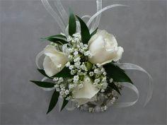 white wrist corsage; white roses, baby's breath, ruscus