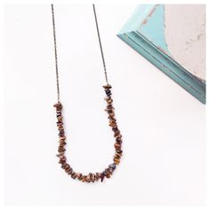 I love this long tiger eye necklace. It slips over your head, and goes with everything!