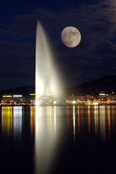 """""""2007-05-29 at 21-14-03"""" by amos lee on Flickr - Jet d'eau, Geneva's magnificent fountain, pictured at night with a full moon, Switzerland."""