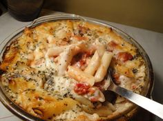 Ingredients:  6 -7 ounces elbow macaroni 1 teaspoon salt 1/4 teaspoon pepper 1 teaspoon dried basil (or 1 Tbsp chopped fresh basil, plus extra for serving) 2 -3 cups mozzarella cheese 14 ounces diced tomatoes, drained For sauce 2 tablespoons olive oil 1 garlic clove, minced 1 tablespoon flour (Debbwl used 2 tablespoons of flour) 1/2 teaspoon salt 1/4 teaspoon pepper 2 cups milk