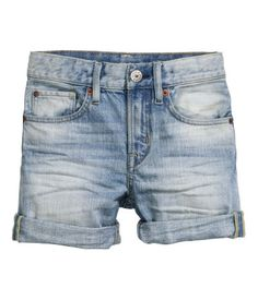 5-pocket, knee-length shorts in washed cotton denim with an adjustable elasticized waistband and zip fly with snap fastener.