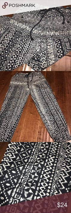 Loft Tribal Navy and White Capri Joggers Ann Taylor Loft Navy and white tribal print capri joggers. Ties at waist and fitted around ankle. Fabric does not stretch. In excellent condition. LOFT Pants Capris