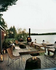 Beachfront cabin deck with outdoor fireplace.