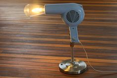 Repurpsed hair dryer. Upcycled into desk lamp with LED bulb. #repuposed #diy more like this: www.upcycle-it.ch