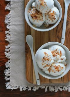 Vegan Coconut Ice Cream | Girl Cooks World. Made like haupia (coconut milk, cornstarch, sugar, cook) and then chilled and churned.