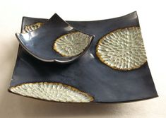 Ceramic Platter Set--These striking serving pieces are sure to become a perennial favorite. Each features stylized chrysanthemums and is hand-carved and glazed. No two will be alike. Food safe.