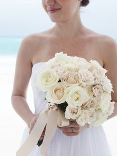 White wedding flowers and white sand beaches | Destination Weddings | Beach Weddings | WeddingMoons by Sandals & Beaches. | Sandals Resorts Weddings | Beaches Resorts Weddings
