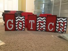 """Adorable """"GoTech"""" chevron block set. Sizes are 4 & 1/2 inches and 4 inches tall. Made of wood and paper. Guaranteed not to fade in the sunlight. Purchase for $12.50, shipping not included.  www.lesliegipon.com"""