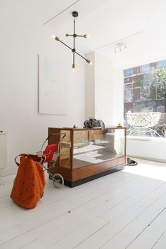 Open for Business: How a Tattoo Artist and a Children's Clothing Designer Set Up Shop in The Hague — Freunde von Freunden Opposites Attract, The Hague, Tattoo Shop, Set Design, Tattoo Artists, Living Room, Children, Interior, Business