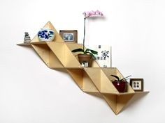 T.SHELF (Triangular shelf) is a modular system that can be built into multiple shapes with various functions.