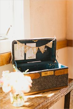 small vintage suitcase with burlap flag banner for cards