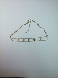 Gothic choker displays your personalized name with individual Old English don't letters connecte