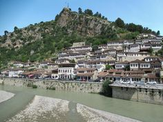 White Ottoman houses climb the hillside between the Osum River and the castle in Berat, Albania. White Ottoman, Albania, Climbing, Southern, Castle, Houses, River, Mansions, House Styles