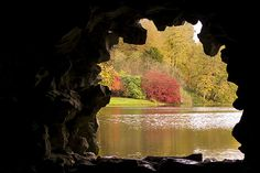 view looking out of a grotto in Stourhead, Wiltshire
