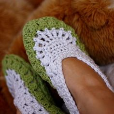 Crocheted Slippers-Years ago I would have called these old lady shoes.I guess I was right because now I want a pair.I'm ruining my socks from not wearing shoes outside.( It's a southern thing)