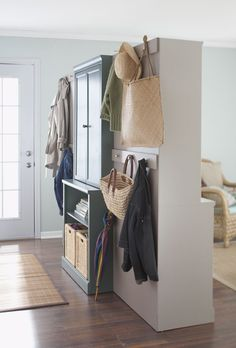 "Living room side of the room divider made of three ready-to-assemble cabinet units (view of side B) **maybe do this with entertainment center in living room with something to cover back for ""walled"" look"