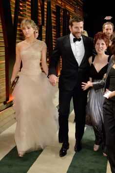 Oscars 2014 - Suki Waterhouse in a Marchesa gown with Harry Winston diamonds and Bradley Cooper.