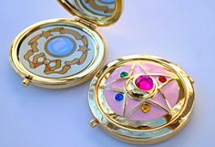 Sailor Moon Crystal Star Compact Brooch Locket/Fully Functional CosPlay Doll Prop  You will receive one compact and decal- Decal included with purchase. (Decal does not come attached for those that do not want it attached.)   Important Information: -The Sailor Moon Crystal Star compact is one of the hardest and more complexed items we make. Please read the listing carefully for important information, to help you the buyer make a choice to buy it or not.  -Compacts may have tiny little sc...