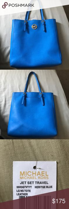MICHAEL KORS JET SET TRAVEL Michael Kors tote. Heritage blue. Leather. A few minor issues, the rubber on the outter seems of the straps have rubbed off on some places. Not noticeable to on lookers. As well as a few minor stains on the bottom of the inner lining. Again not noticeable to anyone looking at the bag. I've never set it on the ground so the bottom is pristine Michael Kors Bags Travel Bags