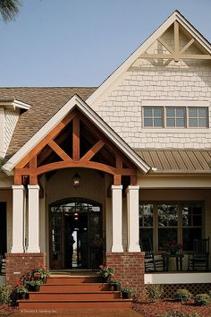 This rustic home has tons of curb appeal with gable brackets and columns framing the front porch. Plan #1125-D - The Cedar Ridge. #Rustic #Exterior #Details
