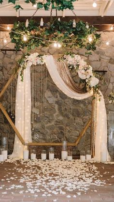A simple, yet incredible backdrop for any elegant event. Wooden hexagon can be created by stained 2x4s (or similar). Find a string of white lights and sheer fabric and the hardest parts are done. Arrange some faux floral arrangements to your liking, and accomplish this beautiful look quickly and without breaking the bank!