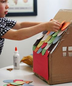 Cardboard house art project. Fun idea for indoor play.
