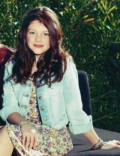love georgie henley's floral dress and denim jacket.  and her hair
